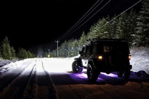 Nightrider Jeep with on winter road long straight stretch showing of light intensity lighting up the road over 1.5km