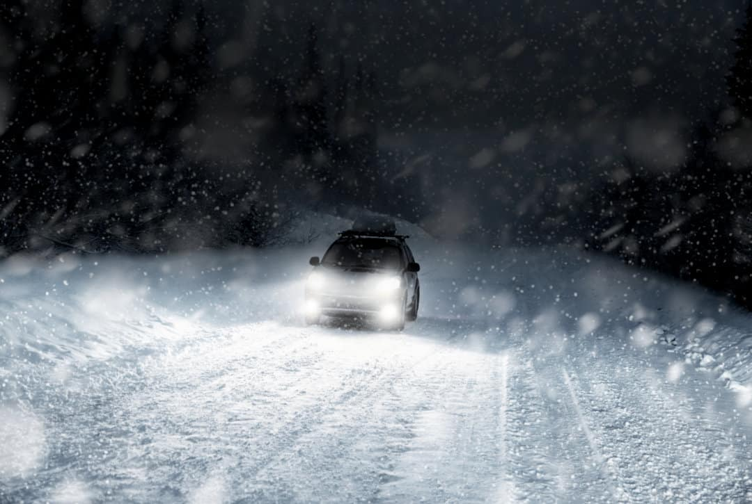 Car with NightRider Fog Lights in winter storm