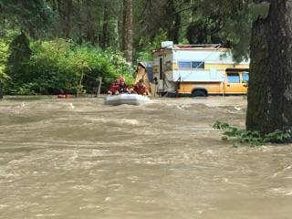Swift water flood zodiac rescue campers