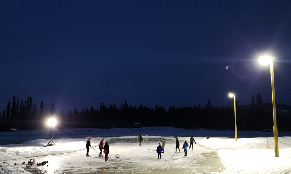 Nightime Pond Hockey with NightRider™ Commercial LEDS Shoe Box Lights