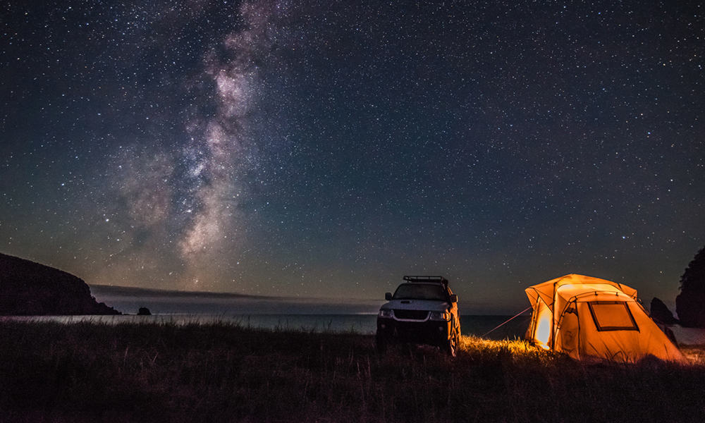Tent & SUV by Shore at Night